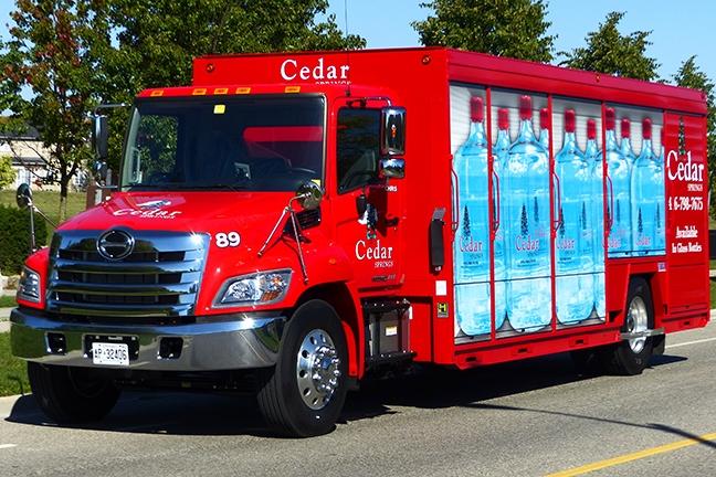 Cedar water branded hino truck