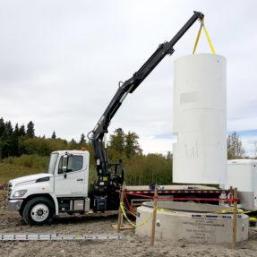 crane lifting cement tubes